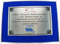 Placa de homenagem por comemoração aos 40 anos de excelência em atendimento e por ser destaque em qualidade e eficiência.